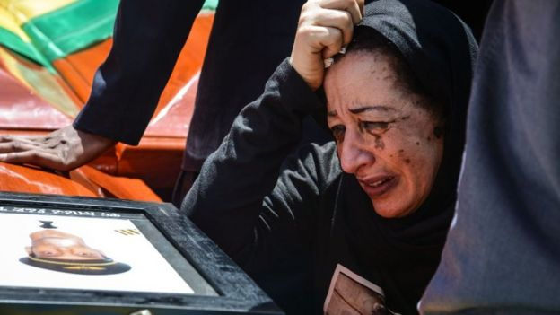 Woman mourns at funeral for victims of the Ethiopian Airlines crash