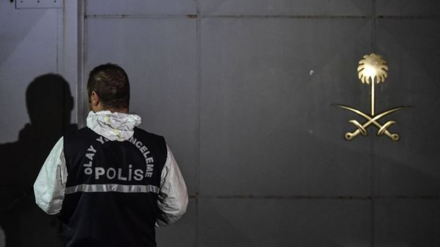 A Turkish forensic officer waits outside the Saudi Arabian consulate in Istanbul 17 October 2018