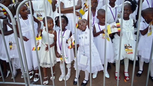 School children wait for Pope Francis' arrival at Lubaga Cathedral in Kampala on November 28, 2015.