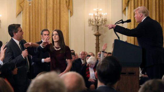 President Donald Trump, journalist Jim Acosta and a White House intern