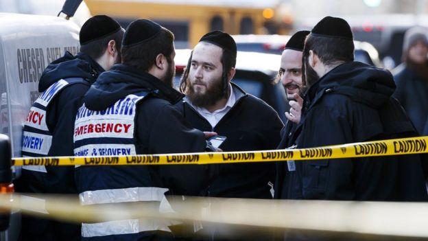 members of Jewish community near the shop