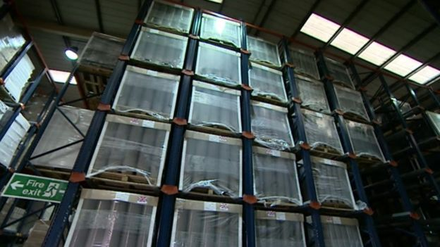A warehouse of the new recyclable pots ready for spring planting & Big changes to recycling black plastic - BBC News