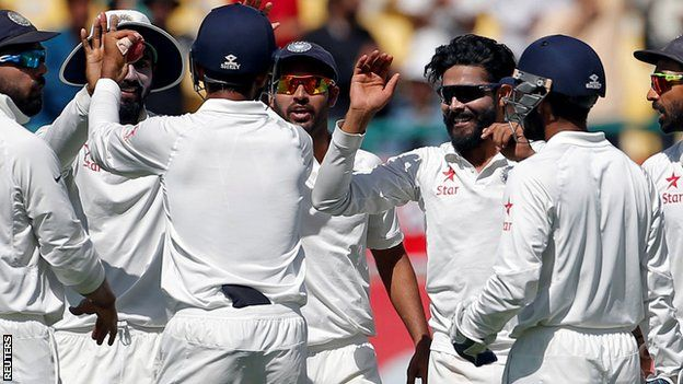 Ravindar Jadeja (third from right) celebrates taking a wicket with his India team-mates
