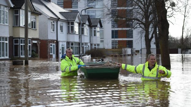 Emergency services use a boat to rescue residents amid flooding in Hereford, western England, on February 17, 2020