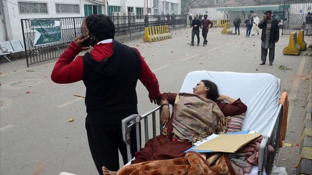 Patients are left outside the Punjab Institute of Cardiology (PIC), after lawyers clashed with police and stormed the hospital in Lahore 11 December 2019