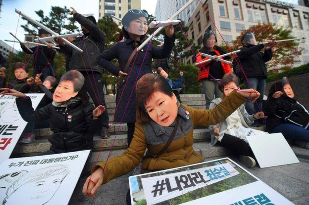 Protesters wearing masks of South Korean President Park Geun-Hye