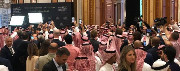 A media scrum as Crown Prince Mohammed bin Salman arrives at the conference
