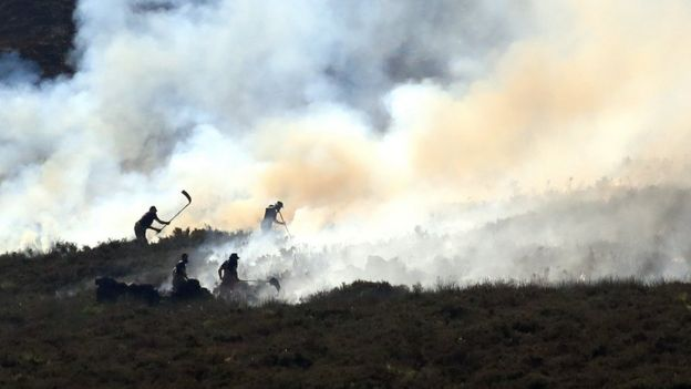 Fire crews continue to fight a large wildfire on the moors above Stalybridge