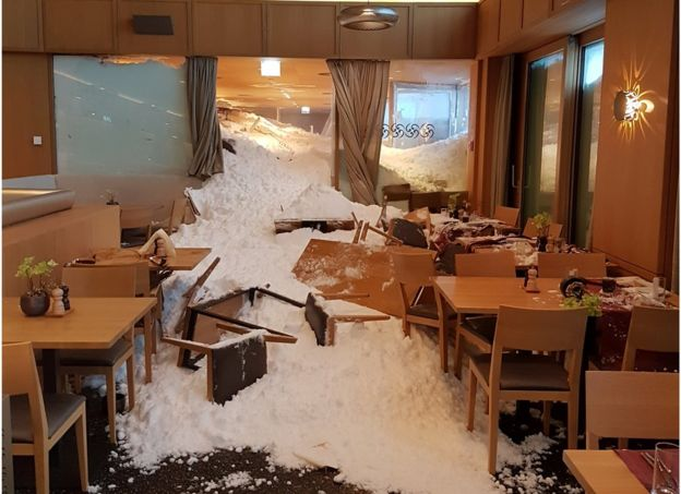 The snow is seen at the Säntis hotel after an avalanche hit it in Schwägalp, Switzerland