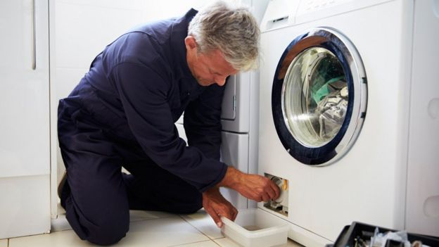 Man repairing washing machine