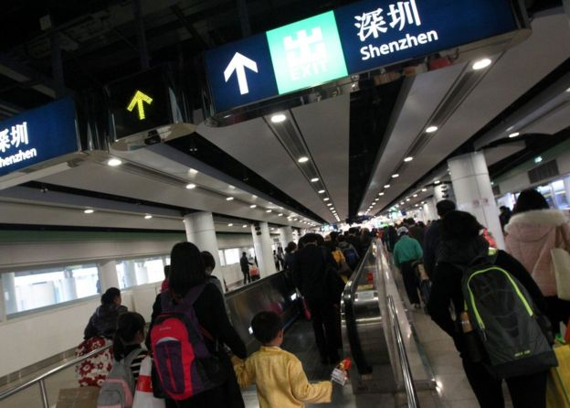 Travellers crossing the border to Shenzhen at the Lo Wu border