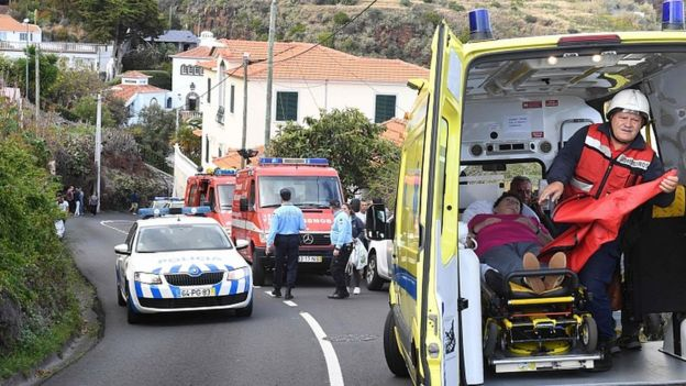 A woman receives medical treatment on April 17, 2019 in Caniço, on the Portuguese island of Madeira