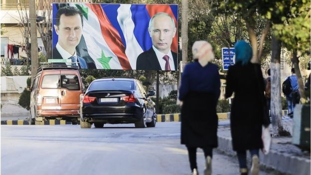 A banner with photos of Bashar al Asad, president of Syria, and Vladimir Putin, president of Russia