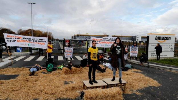 Activists block an Amazon centre in Bretigny-sur-Orge to protest the company's impact on climate change