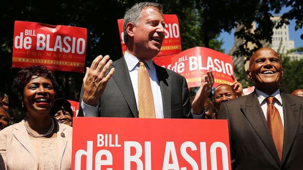 New York Mayor Bill de Blasio on the campaign trail in 2013 with his wife and entertainer Harry Belafonte