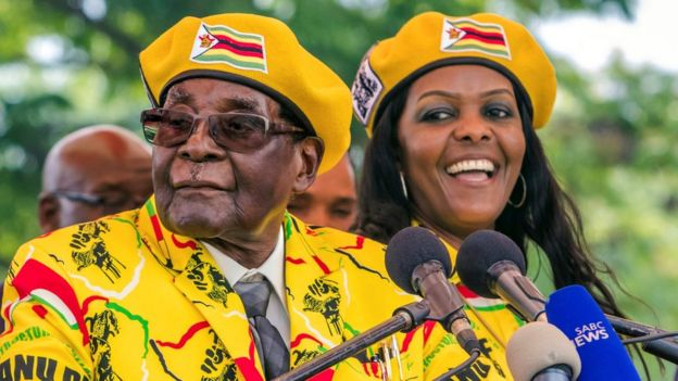 Zimbabwe's President Robert Mugabe addressing party members and supporters with Grace Mugabe (R) November 8, 2017
