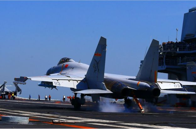 This photo taken on April 24, 2018 shows a J15 fighter jet landing on China's sole operational aircraft carrier, the Liaoning, during a drill at sea. - A flotilla of Chinese naval vessels held a 'live combat drill' in the East China Sea, state media reported early April 23, 2018, the latest show of force by Beijing's burgeoning navy in disputed waters that have riled neighbours. (Photo by - / AFP) / China OUT (Photo credit should read -/AFP/Getty Images)