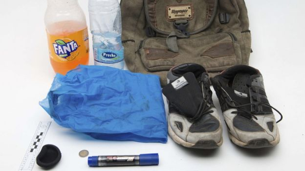 two bottles, pair of shoes, rucksack and coins