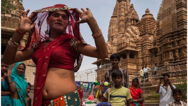 A group of hijras dancing in front of Khajuraho temples in Madhya Pradesh, India.