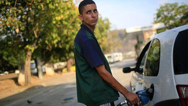 Man filling car up in Brazil