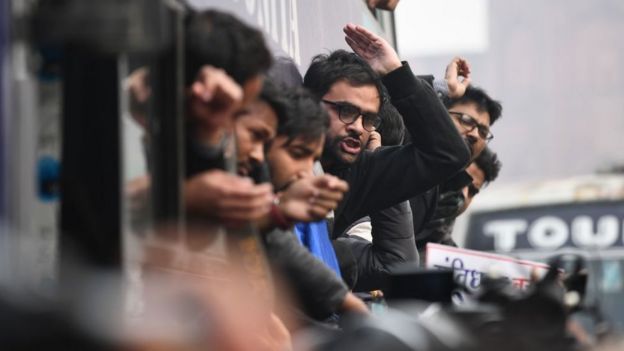Protesters react from a bus after being arrested at a demonstration against India's new citizenship law in New Delhi on December 19, 2019.