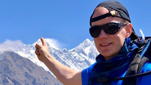 British man Robin Haynes Fisher pointing at Mount Everest before his ascent
