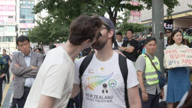 Two Western men kiss at the Incheon Queer festival