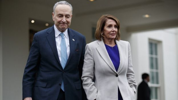Speaker of the House Nancy Pelosi (R) and Senate Minority Leader Chuck Schumer (L) walk out of the West Wing,