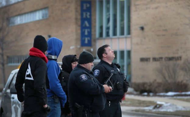 Police secure the area following a shooting at the Henry Pratt Company in Aurora, Illinois, 15 February 2019