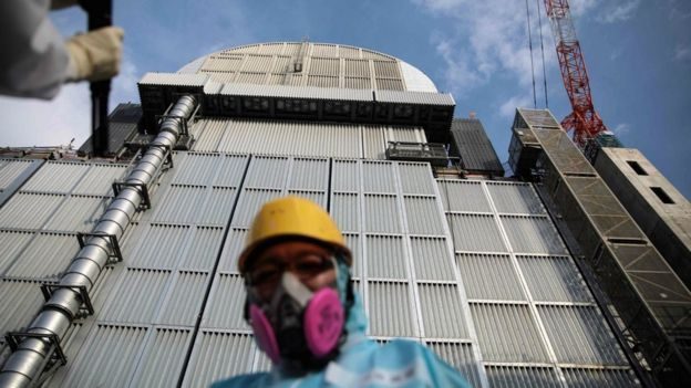 Tepco employee in front of the reactor three at Fukushima Daiichi nuclear power plant in Okuma, Fukushima prefecture, 31 Jan 2018