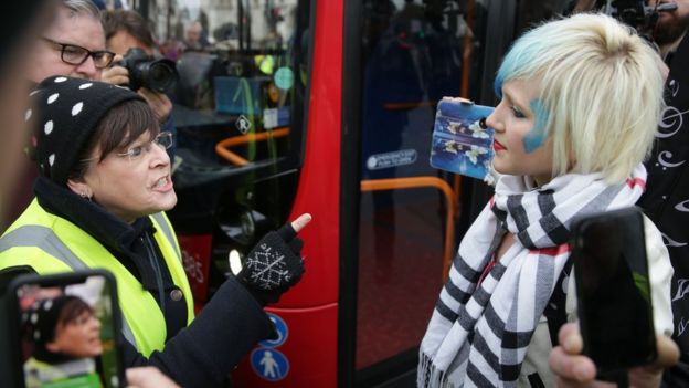 A Pro-Brexit protester argues with a woman holding opposing views in Parliament square during a demonstration in central London