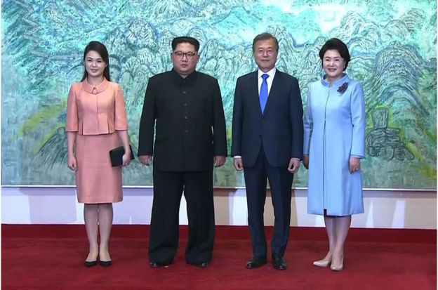 "This screen grab from the Korean Broadcasting System (KBS) taken on April 27, 2018 shows North Korea""s leader Kim Jong Un (2nd L) and his wife Ri Sol Ju (L) posing for a photo with South Korea""s President Moon Jae-in (2nd R) and his wife Kim Jung-sook (R) at the end of their historic summit at Panmunjom."