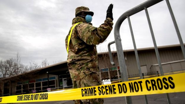 A US National Guard soldier directs patients at a coronavirus testing centre in the Bronx, New York City, 28 March 2020