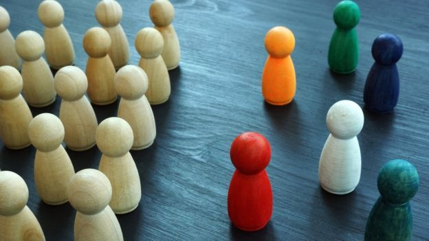 Diversity and Inclusion concept. Wooden and coloured figurines