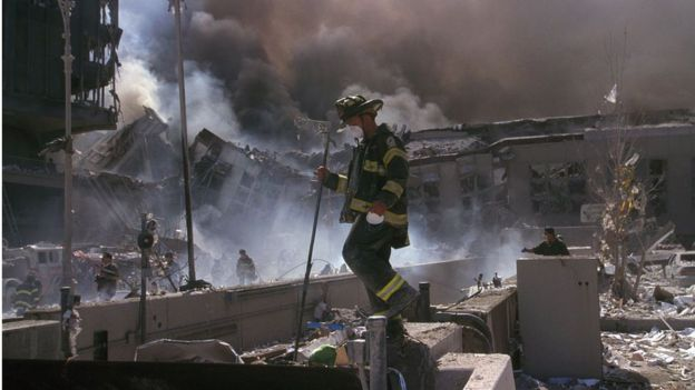Firefighter in rubble of World Trade Center