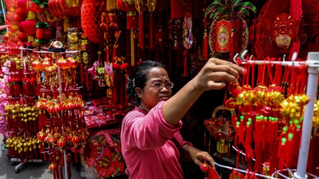 A woman at a shop selling Lunar New Year decorations in Jakarta, Indonesia