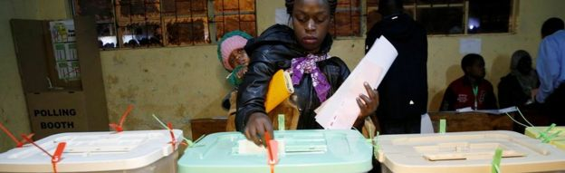 Woman casts her vote at a polling station during the presidential election in Kibera, Nairobi, Kenya August 8, 2017