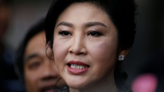 Former Thai prime minister Yingluck Shinawatra speaks to the media as she arrives to deliver closing statements in her trial for alleged criminal negligence over her government