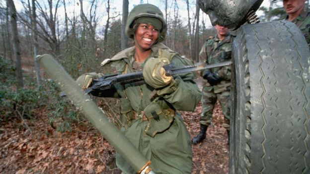 A US soldier stabs a target with a bayonet