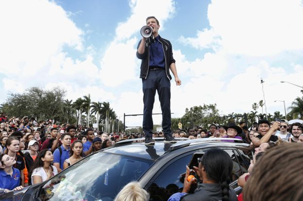 Cameron Kasky speaking to a rally at Marjory Stoneman Douglas High School after participating in a county wide school walk out
