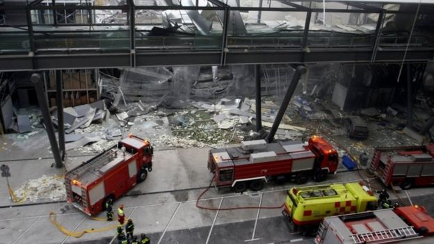 This file photo (taken on 30 December 2006) at Barajas Airport in Madrid shows firemen working inside the car park of Terminal 4, after a bomb exploded claimed by Basque separatist group Eta