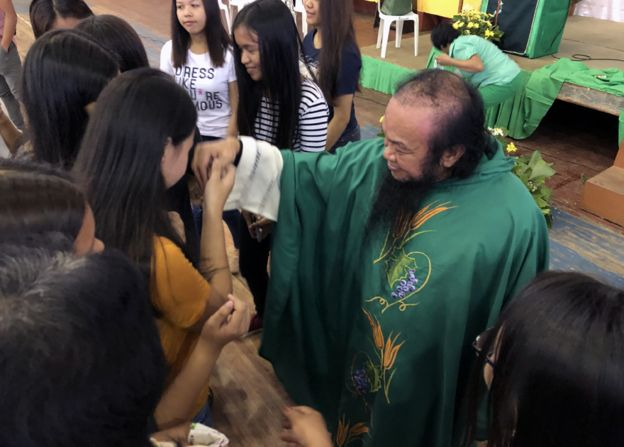 Father at Chito at church in university gymnasium