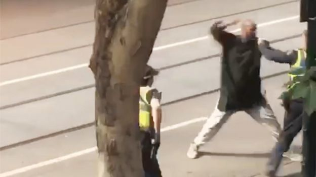 A screenshot shows an incident in which a man armed with a knife attacked several people on Bourke Street