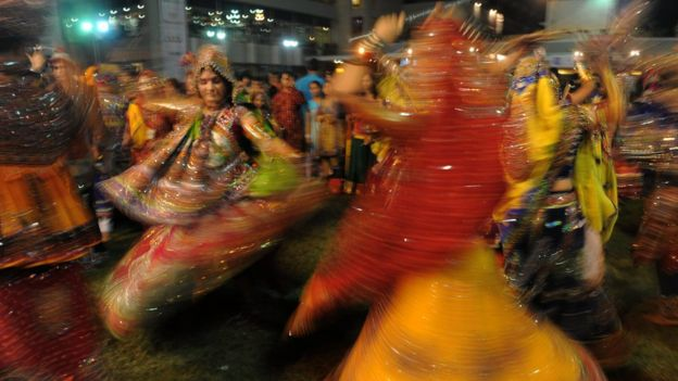 Indian dancers participate on the first day of Navratri at the Sports Club of Gujarat in Ahmedabad late on September 28, 2011