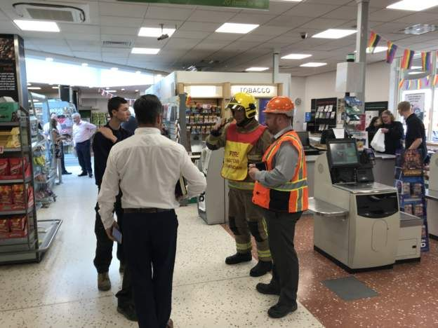 Emergency services inside with staff members