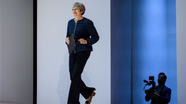 Theresa May walks onto the stage at Davos