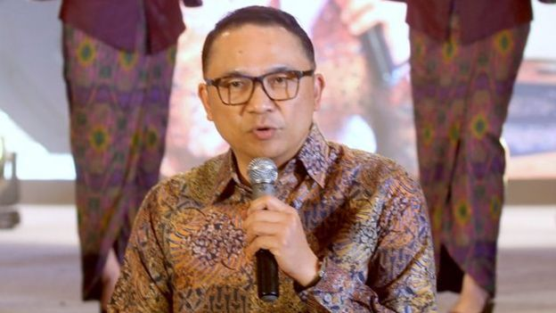 Indonesian national airline Garuda's CEO Ari Askhara speaks during a launch for new flight attendent uniforms, in Jakarta