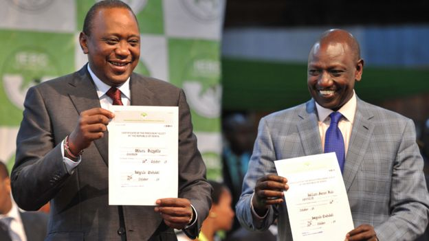 President Kenyatta holds up certificate of election