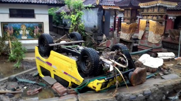 a ruined car that was rolled over after a tsunami hit Sunda Strait, in Anyer, Banten, Indonesia, 23 December 2018