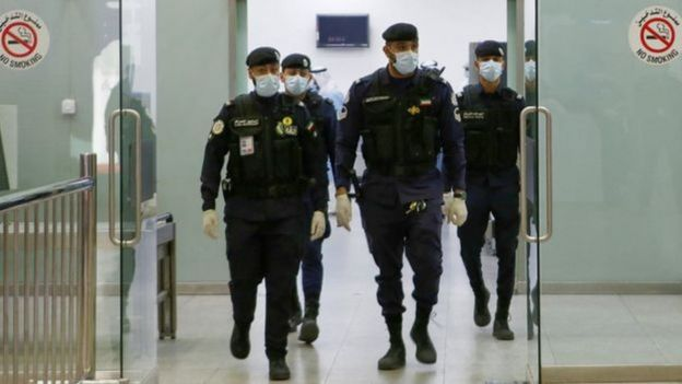 Kuitwin security officers wearing a muzzle.
